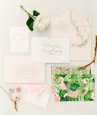 tropical-wedding-invitation-suite-with-green-fronds-and-flamingos-on-the-cover-and-map-of-florida
