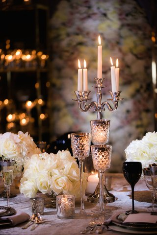 wedding-reception-table-with-silver-candelabra-stemmed-mercury-glass-candleholders-white-roses