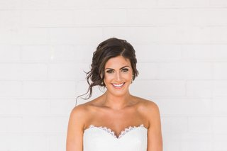 bride-smiling-with-hair-back-and-strapless-sweetheart-dress