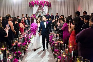 asian-bride-and-groom-wedding-inspiration-fuchsia-orchids-purple-orchids-guests-taking-photos