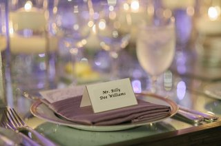 lavender-napkin-on-top-of-wedding-table-with-simple-tent-escort-card