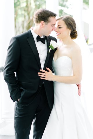 classically-dressed-groom-tux-embracing-bride-southern-wedding-suzanne-neville-love-first-look