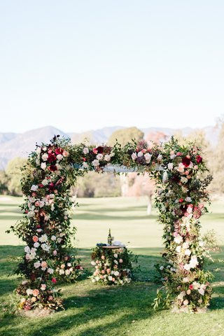 floral-chuppah-and-table-during-outdoor-fall-jewish-wedding