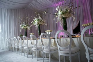 kandi-burrusss-white-reception-table-with-purple-lighting