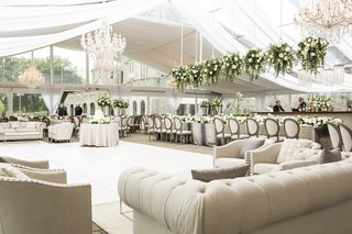 champagne-hued-lounge-space-around-dance-floor-wedding-reception-tan-comfy-floral-chandeliers