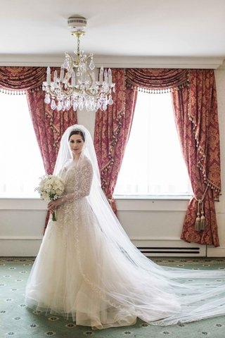 elegant-bride-detailed-wedding-gown-ball-gown-long-sleeves-tulle-full-chapel-length-veil