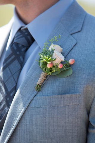 groom-in-grey-suit-with-pattern-tie-and-rustic-boutonniere-succulent-small-rose-buds-berries-green