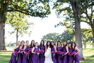 bride-in-monique-lhuillier-mermaid-wedding-dress-bridesmaids-in-eggplant-monique-lhuillier-dresses