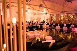 wedding-reception-dancing-ballroom-black-white-furniture-gold-starburst-chandelier-mid-century-style