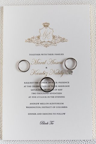 black-tie-wedding-invitation-gold-monogram-crest-with-crown-wedding-rings-on-top