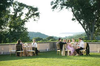 wedding-guests-on-green-lawn-at-picturesque-oheka-castle-in-new-york