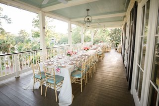 south-carolina-wedding-reception-overflow-seating-tables-on-wrap-around-porch-pastel-color-palette