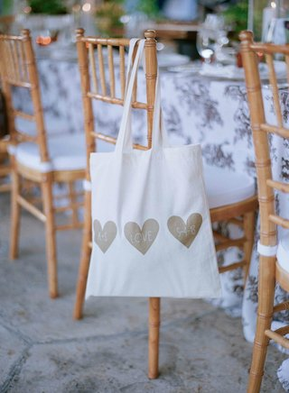 white-tote-bag-with-three-gold-hearts-for-wedding-welcome-bag