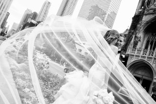 black-and-white-photo-bride-vera-wang-wedding-dress-and-veil-with-husband-on-wedding-day-in-chicago