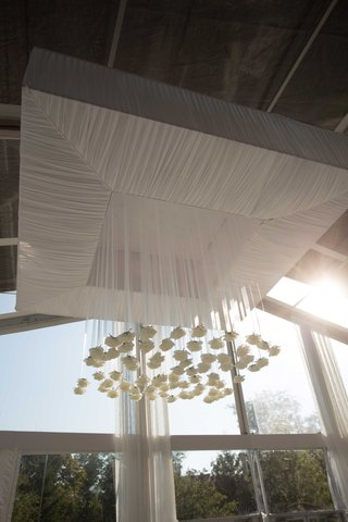 ceiling-flower-arrangement-focal-point-rose-flowers-from-white-sheer-ribbons