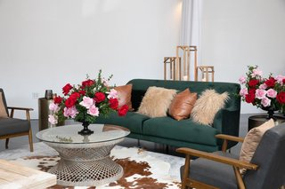 kentucky-derby-themed-bridal-shower-emerald-couch-leather-pillow-cow-skin-rug-red-and-pink-roses