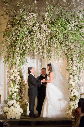 towering-canopy-wedding-arch-with-lush-greenery-and-white-florals