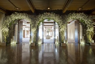 three-flower-arches-at-entrance-to-escort-card-table