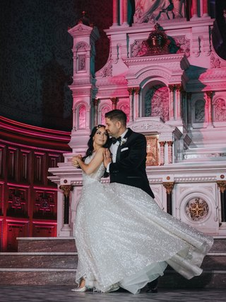 wedding-reception-old-catholic-cathedral-bride-in-sparkle-dress-hair-down-first-dance-in-front-altar