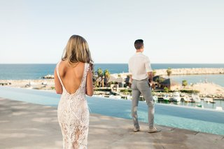 bride-in-sexy-yolancris-backless-wedding-dress-walks-up-to-groom-for-first-look