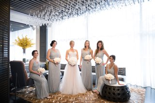 bride-in-wedding-dress-with-bridesmaids-in-v-neck-adrianna-papell-dresses-from-bhldn-sequin-beads