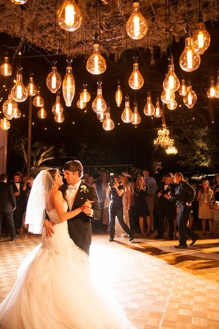 unique-edison-light-bulb-lighting-design-at-outdoor-wedding-reception-first-dance-to-country-song
