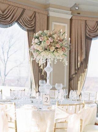 wedding-reception-gold-chairs-with-ribbon-bow-back-calligraphy-table-number-in-frame-crystal-candles