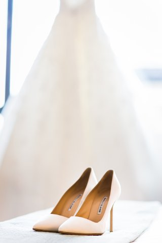 bride-wedding-dress-in-background-with-manolos