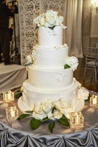 four-layer-cake-with-lace-design-and-fresh-flowers