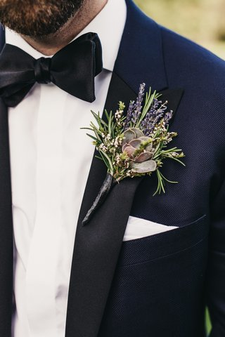 grooms-boutonniere-featuring-a-succulent-accented-with-rosemary-and-lavender-blooms