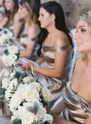 wedding-ceremony-in-italy-bridesmaids-in-metallic-champagne-bronze-dresses-white-rose-bouquets