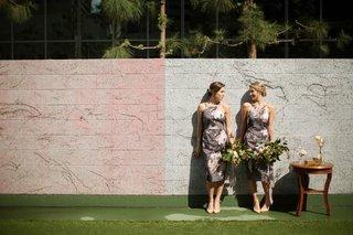 bridesmaids-in-asos-dresses-pose-near-wall