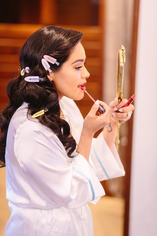 dominique-gonzales-chachis-world-bride-puts-on-lip-gloss-before-wedding