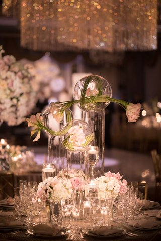 wedding-reception-centerpiece-round-table-tall-hurricane-vase-glass-orb-pink-tulip-rose-white-roses