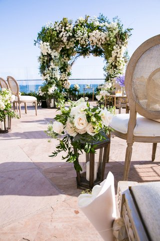 wedding-ceremony-decor-rustic-chair-french-style-lantern-with-roses-greenery-arch-ocean-view