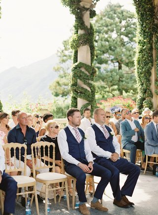 groomsmen-and-wedding-guests-at-lake-como-wedding-ceremony-villa-del-balbianello-greenery-italy