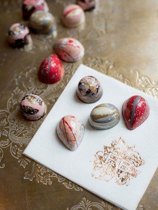 wedding-reception-truffle-hand-painted-desserts-white-napkin-rose-gold-monogram