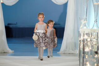 two-flower-girls-in-ruffle-skirt-dresses-in-grey-and-gloves