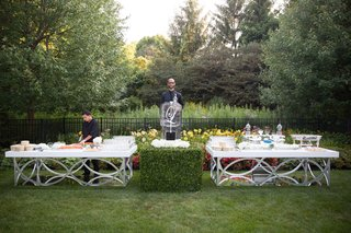 outdoor-backyard-wedding-with-cocktail-hour-white-silver-bar-ice-sculputures-boxwood-hedge