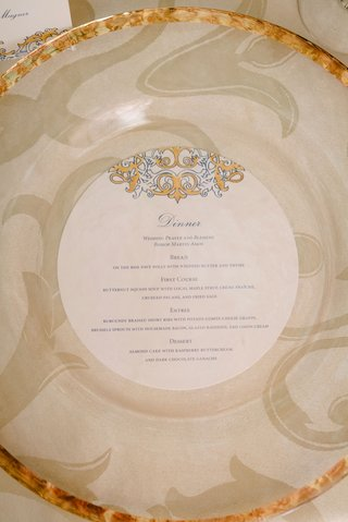 wedding-reception-place-setting-gold-rim-charger-plate-round-menu-card-gold-blue-design-motif