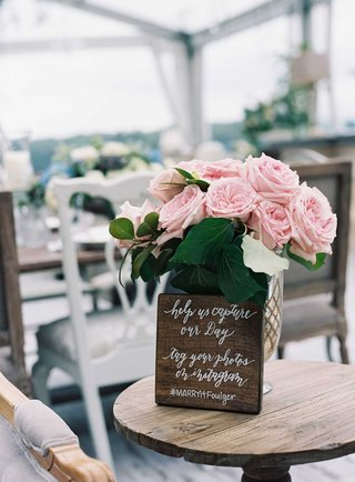 laura-hooper-calligraphy-wood-sign-with-instagram-hashtag-for-wedding-day
