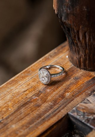 ring-with-halo-setting-and-diamonds-on-band