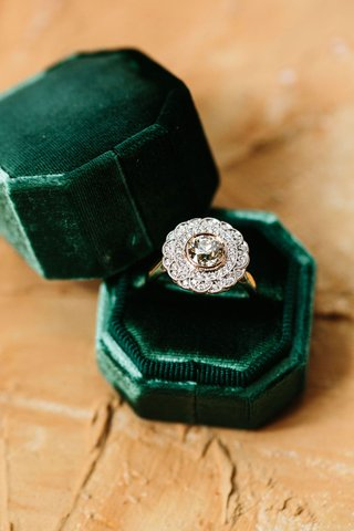 wedding-ring-single-stone-with-ornate-halo-design-art-deco-style-green-velvet-ring-box-emerald