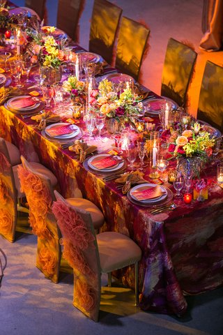 fire-inspired-wedding-styled-shoot-glittery-orange-decorative-chair-covers-warm-colors-linen