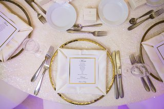 white-tablescape-gilt-rimmed-chargers-indian-hindu-wedding-california-purple-lighting-napkin