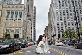 bride-and-groom-share-kiss-in-chicago-in-the-middle-of-michigan-avenue
