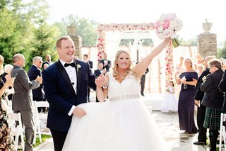 wedding-ceremony-outdoor-spring-summer-pink-flowers-bride-and-groom-recessional-guests-celebrating