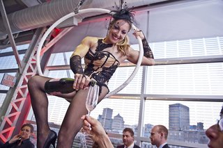 burlesque-style-acrobat-on-hoop-pours-guests-champagne