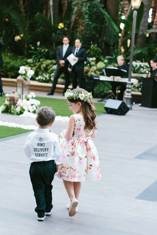 ring-bearer-in-ring-delivery-service-button-up-shirt-and-flower-girl-in-flower-crown-floral-dress