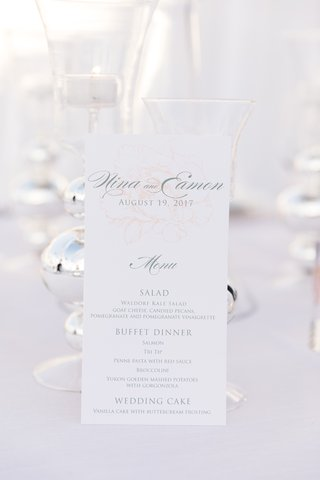wedding-reception-menu-with-subtle-pink-rose-drawing-in-background